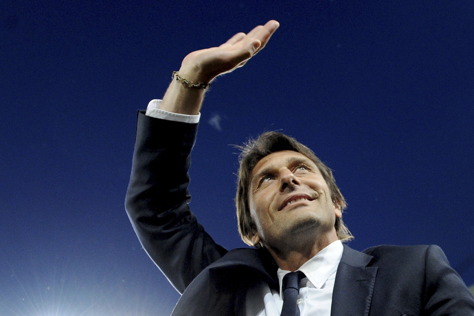 Photo - FILE - In this May 5, 2014 file photo, Juventus coach Antonio Conte waves to supporters prior to the start of a Serie A soccer match between Juventus and Atalanta at the Juventus stadium, in Turin, Italy. Former Juventus manager Antonio Conte is the new coach of Italy, after signing a two-year contract. The Italian football federation announced the news on Thursday, Aug. 14, 2014 three days after new president Carlo Tavecchio was elected. The 45-year-old Conte replaces Cesare Prandelli, who resigned, along with former FIGC president Giancarlo Abete, immediately after Italy's early elimination from the World Cup in Brazil. (AP Photo/Massimo Pinca, File)