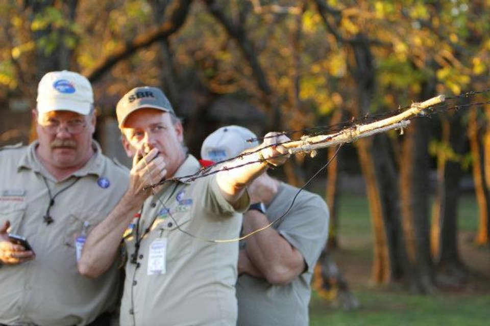 Photo - Mark Hamblin, left, and Doug Cook with the Radio Scouter Group try to contact the International Space Station with a barb wire antena and a 5 wat radeo during the 54th Jamboree-On-The -Air last weekend.  David McDaniel - THE OKLAHOMAN