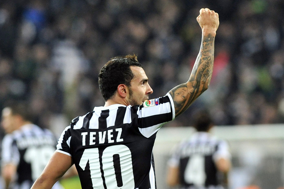 Photo - Juventus forward Carlos Tevez, of Argentina, celebrates after scoring  during a Serie A soccer match between Juventus and Torino at the Juventus stadium, in Turin, Italy, Sunday, Feb. 23, 2014. (AP Photo/Massimo Pinca)
