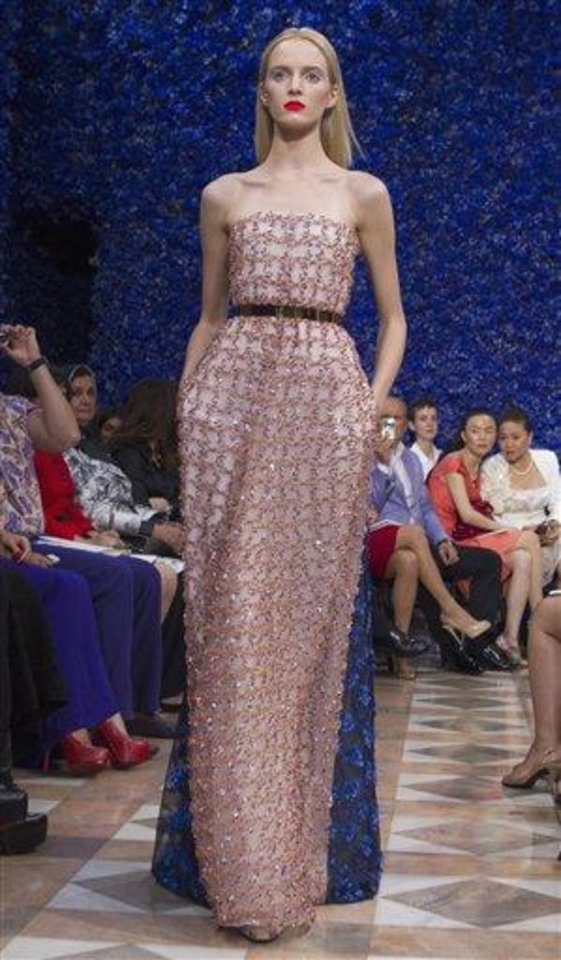 Photo - A model wears a creation by fashion designer Raf Simons for Dior, during his Women's Fall Winter 2013 haute couture fashion collection, during fashion week in Paris, France, Monday, July 2, 2012. (AP Photo/Jacques Brinon)