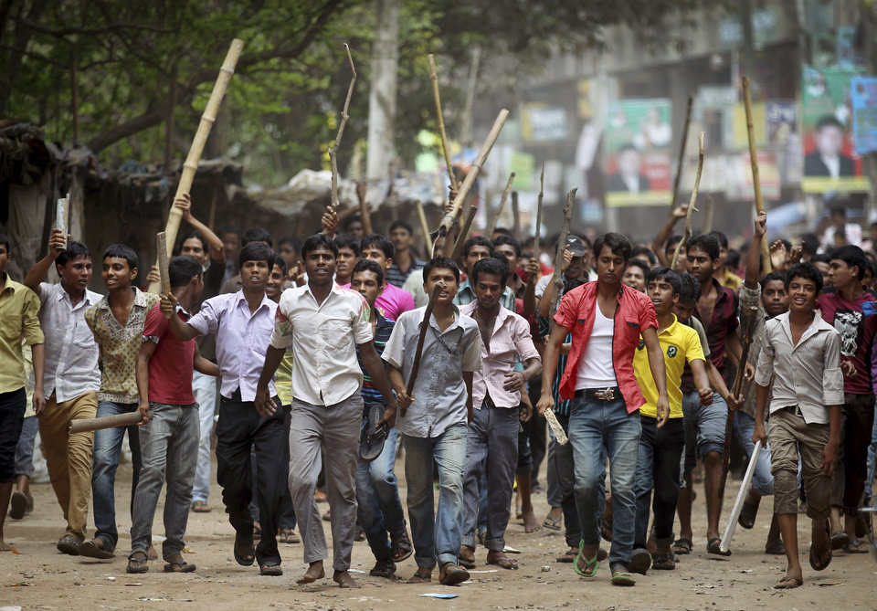 "Protestors march down a street demanding the death penalty for those responsible for the collapsed garment factory building, killing hundreds, Tuesday, April 30, 2013 in Savar, near Dhaka, Bangladesh.  A top Bangladesh court on Tuesday ordered the government to ""immediately"" confiscate the property of a collapsed building's owner, as thousands of protesters demanding death penalty for the man clashed with police, leaving 100 people injured. (AP Photo/Wong Maye-E)"