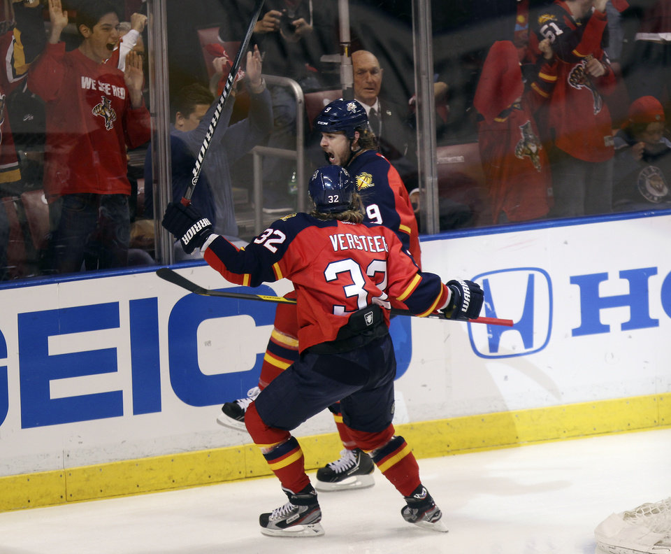 Photo -   Florida Panthers player Stephen Weiss (9) celebrates his goal with Kris Versteeg (32) during the first period of Game 2 of an NHL hockey Stanley Cup first-round playoff series in Sunrise, Fla., Sunday, April 15, 2012, against the New Jersey Devils. (AP Photo/J Pat Carter)