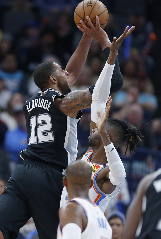 Photo - San Antonio's LaMarcus Aldridge (12) shoots over Oklahoma City's Nerlens Noel (9) during an NBA basketball game between the Oklahoma City Thunder and the San Antonio Spurs at Chesapeake Energy Arena in Oklahoma City, Tuesday, Feb. 11, 2020. [Bryan Terry/The Oklahoman]