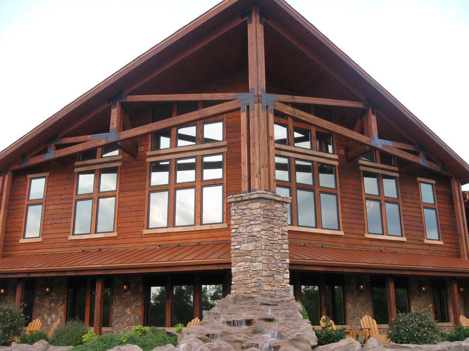 Constructed of stone and wavy red cedar, the lodge at Stonewater Cove strikes a formidable pose on the shoreline of Table Rock Lake. PHOTO BY PAULA BURKES, THE OKLAHOMAN <strong></strong>