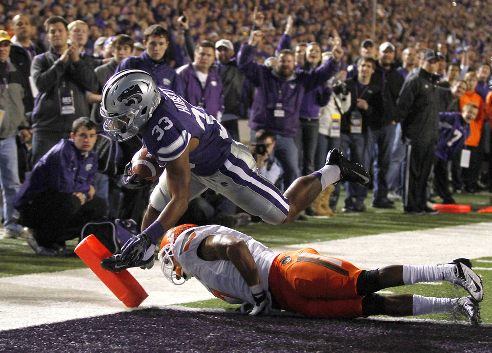 Photo - Kansas State's John Hubert (33) scores a touchdown past Oklahoma State's Shamiel Gary (7) during the college football game between the Oklahoma State University Cowboys (OSU) and the Kansas State University Wildcats (KSU) at Bill Snyder Family Football Stadium on Saturday, Nov. 1, 2012, in Manhattan, Kan. Photo by Chris Landsberger, The Oklahoman
