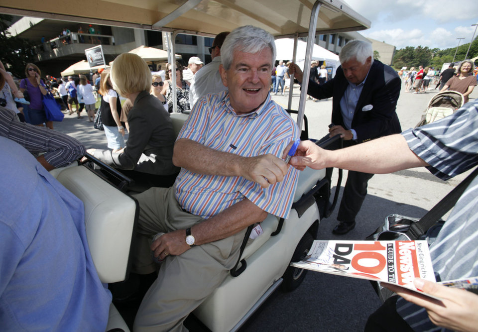 Photo -   Former House Speaker Newt Gingrich greets Iowa Republicans during the Iowa Republican Party's Straw Poll, Saturday, Aug. 13, 2011, in Ames, Iowa. (AP Photo/Charlie Neibergall)