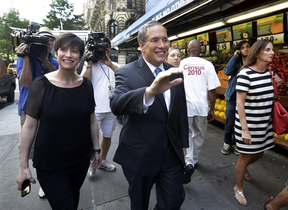 Photo - Manhattan Borough President Scott Stringer, and his wife Elyse Buxbaum, campaign on New York's Upper West Side,  Monday, July 8, 2013. Stringer has been the most prominent among the contenders to become New York City's next fiscal chief. He's raised more than $3.5 million and spent about $566,000, city campaign finance records show, while his opponents have yet to report any fundraising or spending.(AP Photo/Richard Drew)