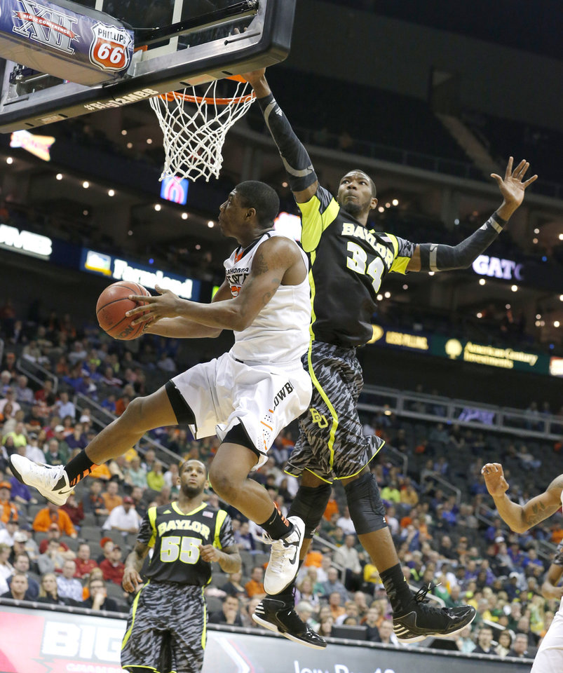 Photo - Oklahoma State's Marcus Smart (33) shoots a lay up as Baylor's Cory Jefferson (34) defends during the Phillips 66 Big 12 Men's basketball championship tournament game between Oklahoma State University and Baylor at the Sprint Center in Kansas City, Thursday, March 14, 2013. Photo by Sarah Phipps, The Oklahoman