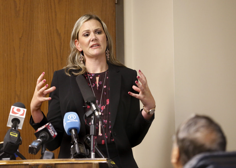 Photo - Juli Ezell,  general counsel for the health department, explains proposed regulations to board members. The Oklahoma State Department of Health voted at their monthly meeting Tuesday morning, July 10, 2018, to ban sales of smokeable forms of medical marijuana and to require dispensaries to hire a pharmacist. The Board of Health voted on 75 pages of rules creating a rough framework for patients, physicians, caretakers and business owners interested in medical marijuana. The ban on sales of leaves and flowers for smoking and the requirement to hire a pharmacist weren't in the draft rules presented to the board, but were a priority of a coalition of medical groups. Julie Ezell, the Health Department's general counsel, presented the rules to a packed board room and to members of the public watching in an overflow room and online. She cautioned board members that the two new rules they added might not be allowed under the state question, inviting a court challenge. Photo by Jim Beckel, The Oklahoman