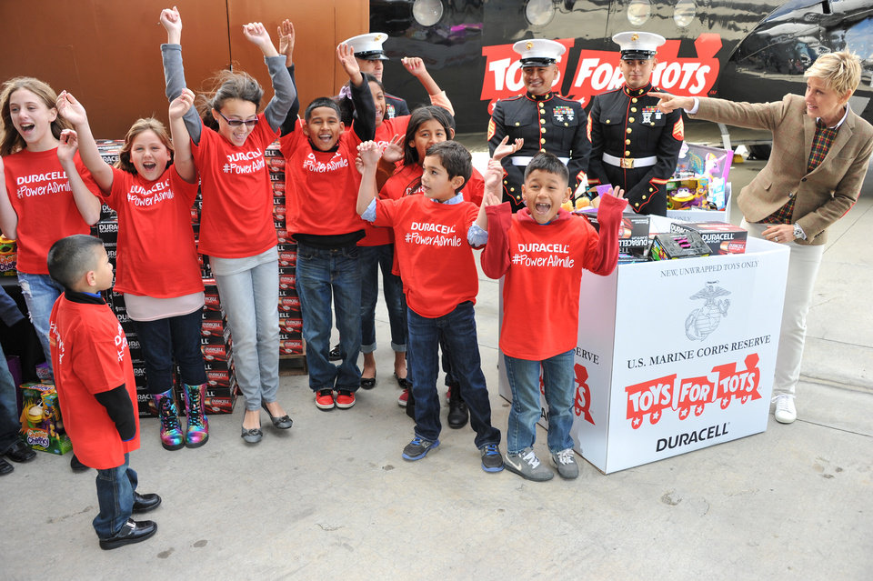 Photo - Ellen DeGeneres, far right, with U.S. Marines and her helpers attend the Ellen DeGeneres officially launches the Duracell