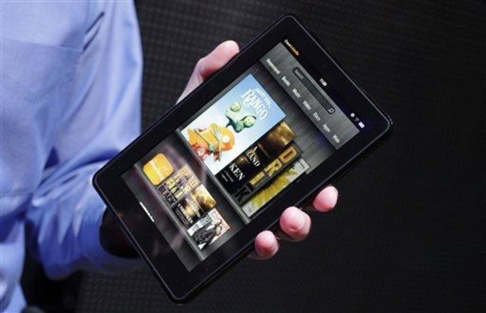 Photo - FILE - This Wednesday, Sept. 28, 2011 file photo shows the Kindle Fire  at a news conference in New York. The tablet computer is without a doubt the gift of the year. just like it was last year. But if you resisted the urge in 2011, now is the time to give in. This season's tablets are better all around. Intense competition has kept prices very low, making tablets incredible values compared to smartphones and PCs (AP Photo/Mark Lennihan, File)