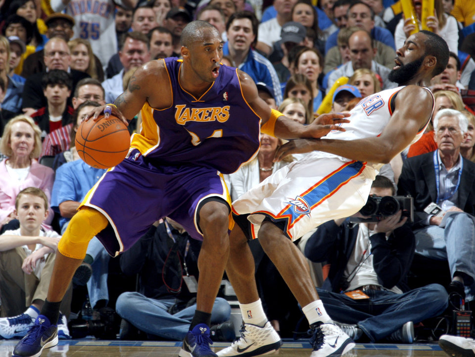 Photo - Oklahoma City's James Harden (13) takes a charge form Lakers' Kobe Bryant (24) during the NBA basketball game between the Oklahoma City Thunder and the Los Angeles Lakers, Sunday, Feb. 27, 2011, at the Oklahoma City Arena.Photo by Sarah Phipps, The Oklahoman