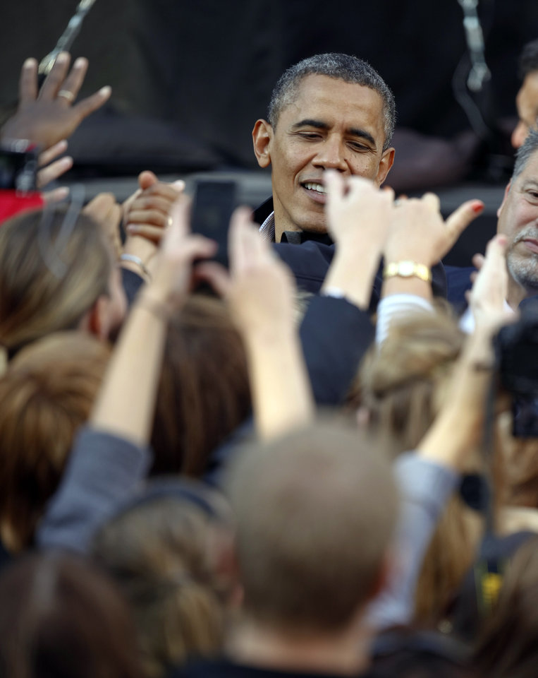 Photo -   President Barack Obama greets supporters after his speech at the University of Wisconsin-Madison during a campaign stop in Madison, Wis., Thursday, Oct. 4, 2012. (AP Photo/Andy Manis)
