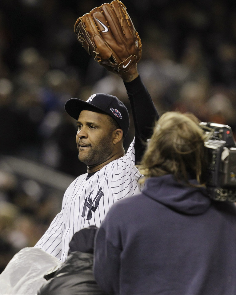 Photo -   New York Yankees starting pitcher CC Sabathia waves to the fans as he leaves the field after Game 5 of the American League division baseball series against the Baltimore Orioles, Friday, Oct. 12, 2012, in New York. The Yankees won the game 3-1 and advanced to the AL championship. (AP Photo/Kathy Willens)