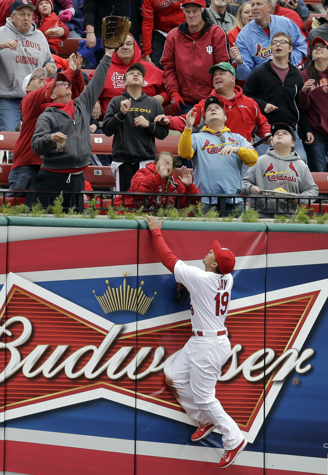 Photo - St. Louis Cardinals center fielder Jon Jay climbs the outfield wall looking for a two-run home run hit by Milwaukee Brewers' Mark Reynolds during the second inning of a baseball game Wednesday, April 30, 2014, in St. Louis. (AP Photo/Jeff Roberson)