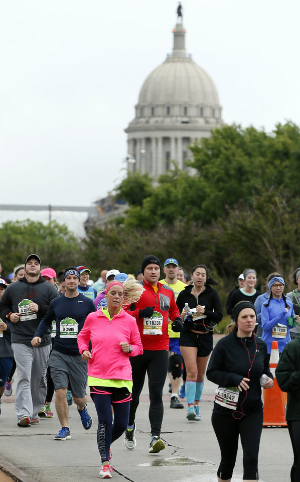 Photo - Runners make their way west on NE 23 after passing the state Capitol during the Oklahoma City Memorial Marathon in Oklahoma City, Sunday, April 30, 2017. Photo by Nate Billings, The Oklahoman