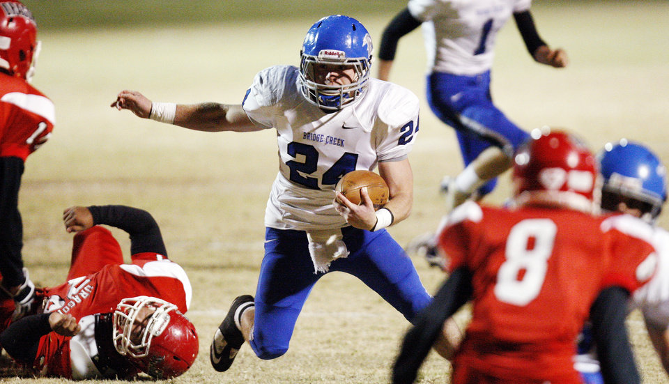 Photo - Chris Golden (24) of Bridge Creek leaves behind a Purcell defender during a high school football playoff game between Purcell and Bridge Creek at Conger Field in Purcell, Okla.,Friday, Nov. 11, 2011. Photo by Nate Billings, The Oklahoman