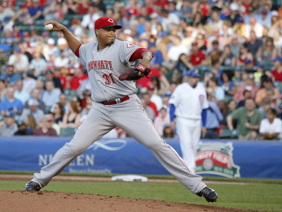 Photo - Cincinnati Reds starting pitcher Alfredo Simon delivers during the first inning of a baseball game against the Chicago Cubs, Monday, June 23, 2014, in Chicago. (AP Photo/Charles Rex Arbogast)
