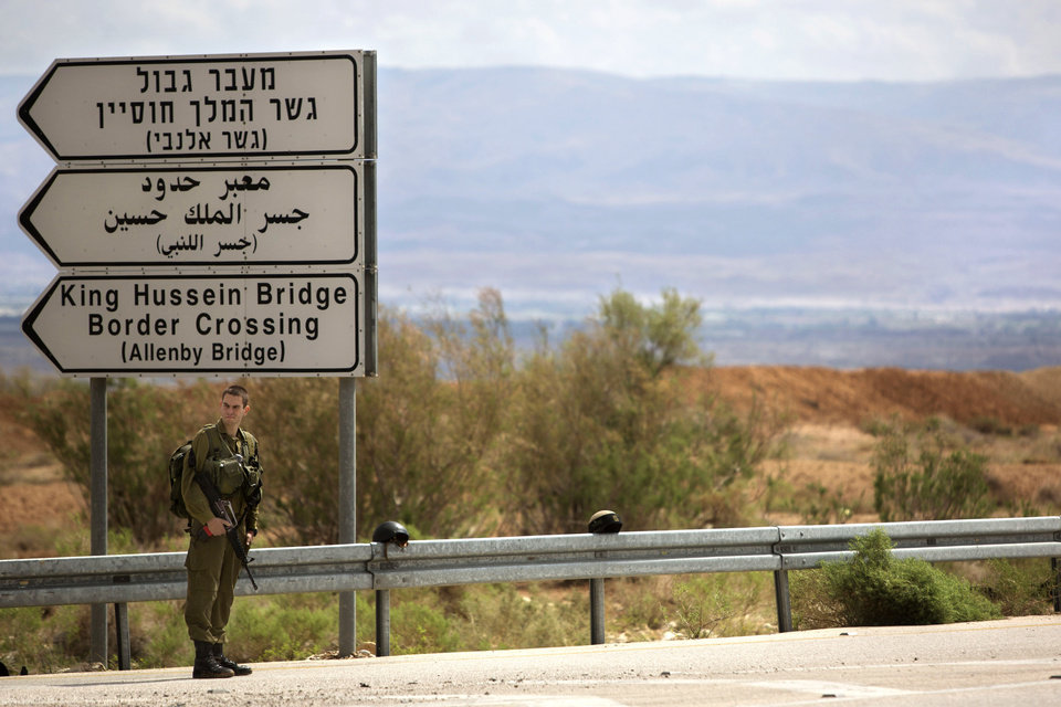 Photo - An Israeli soldier stands at the entrance to the Allenby border crossing, the main border crossing for Palestinians from the West Bank traveling to neighboring Jordan and beyond, Monday, March 10, 2014. Israeli guards shot and killed a Palestinian on Monday as he tried to grab a rifle from an Israeli soldier at the border crossing between the West Bank and Jordan, the military said. (AP Photo/Sebastian Scheiner)