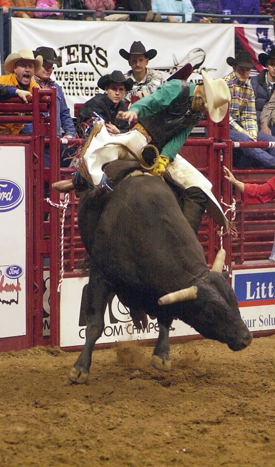IFR: Cord McCoy, of Tupelo, Okla. competes in the bull riding event of the International Finals Rodeo at Ford Center in Oklahoma City.  Staff photo by Michael Downes.