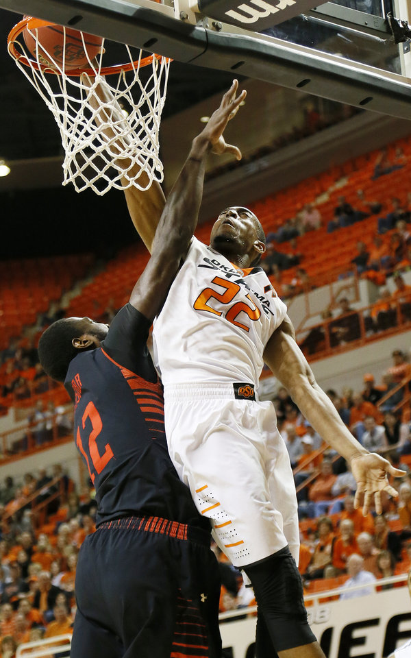 Oklahoma State\'s Markel Brown (22) dunks the ball against Texas Tech\'s Kader Tapsoba (12) during a men\'s college basketball game between Oklahoma State University and Texas Tech at Gallagher-Iba Arena in Stillwater, Okla., Saturday, Jan. 19, 2013. OSU won, 79-45. Photo by Nate Billings, The Oklahoman