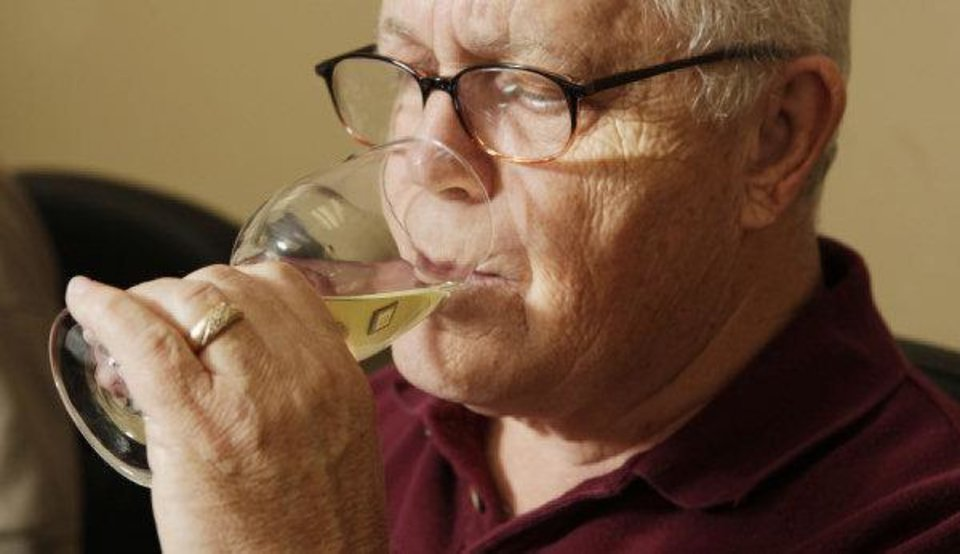 Photo - Wine judge Bob Teeter, of Norman, tastes an entry during the wine competition at the Oklahoma State Fair. The second annual Wine Day at the fair will be today.  PAUL B. SOUTHERLAND - THE OKLAHOMAN