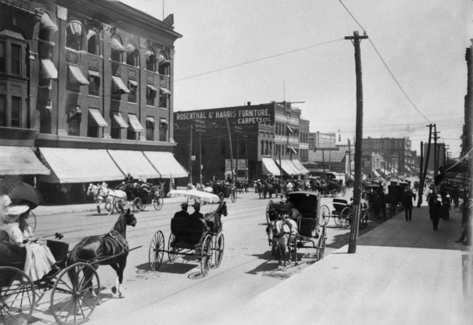 STREET SCENES / OKLAHOMA CITY / HORSES / CARRIAGES:  Additional information: Rosenthal and Harris Furniture's address was 218 North Broadway, Oklahoma City, Oklahoma.
