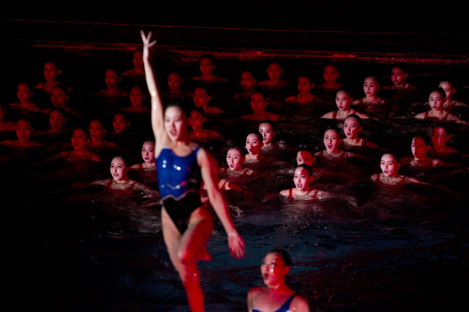 Photo - In this Feb. 15, 2013 photo, North Korean women perform during a mass synchronized swimming event to mark what would have been the birthday of the late leader Kim Jong Il in Pyongyang, North Korea. (AP Photo/David Guttenfelder)