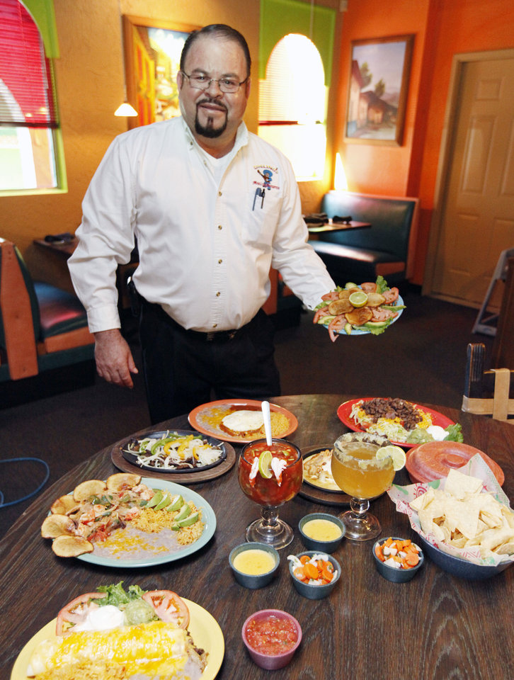 Chelino's owner Marcelino Garcia is surrounded by the food that has helped him open 13 locations in Oklahoma City.  Photo by Paul Hellstern, The Oklahoman <strong>PAUL HELLSTERN - Oklahoman</strong>