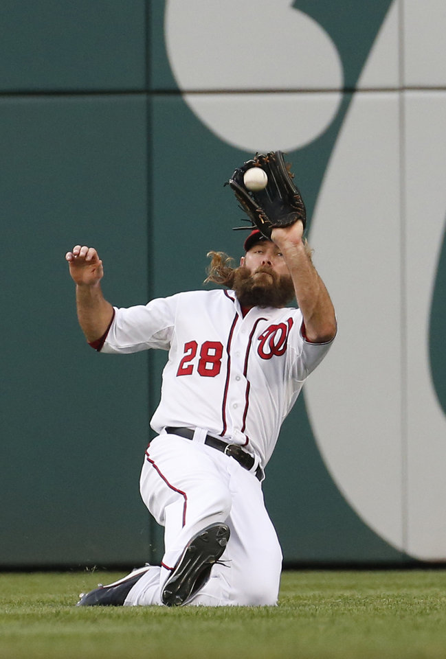 Photo - Washington Nationals right fielder Jayson Werth catches a fly ball hit by New York Mets' Curtis Granderson during the first inning of a baseball game at Nationals Park Wednesday, Aug. 6, 2014, in Washington. (AP Photo/Alex Brandon)