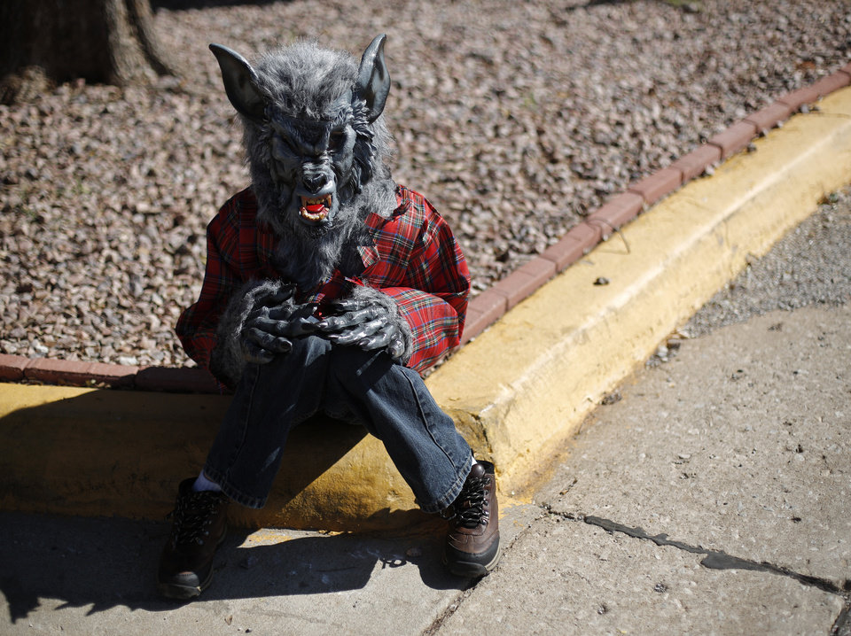 D.J. Liszeski, 8 of Yukon, sits dressed as a werewolf during a dog and child costume show at the Yukon Community Center in Yukon, Okla., Saturday, Oct. 27, 2012.  Photo by Garett Fisbeck, The Oklahoman