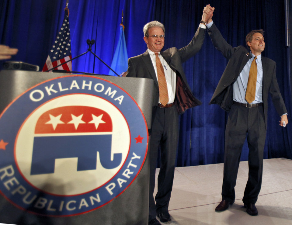 Photo - U.S. Senator Tom Coburn and republican party chairman Matt Pinnell take the stage in front after winning his race for a second term at the republican Watch Party at the Marriott on Tuesday, Nov. 2, 2010, in Oklahoma City, Okla.   Photo by Chris Landsberger, The Oklahoman