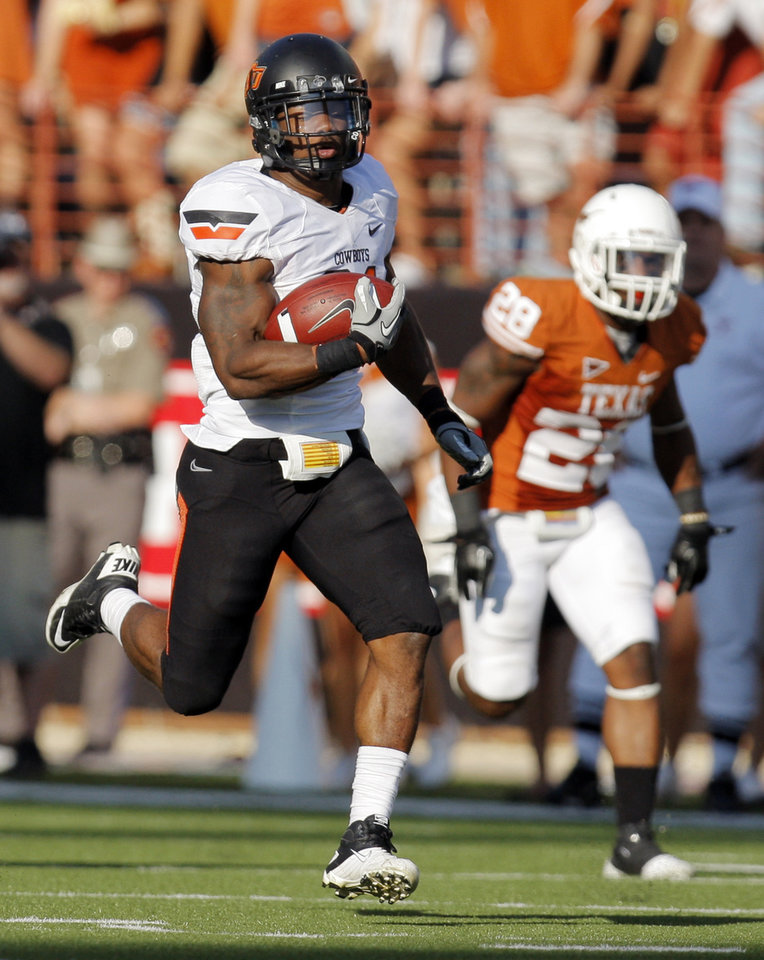 Photo - Oklahoma State's Jeremy Smith (31) breaks away from Texas' Quandre Diggs (28) on a long touchdown run in the third quarter during a college football game between the Oklahoma State University Cowboys (OSU) and the University of Texas Longhorns (UT) at Darrell K Royal-Texas Memorial Stadium in Austin, Texas, Saturday, Oct. 15, 2011. OSU won, 38-26. Photo by Nate Billings, The Oklahoman