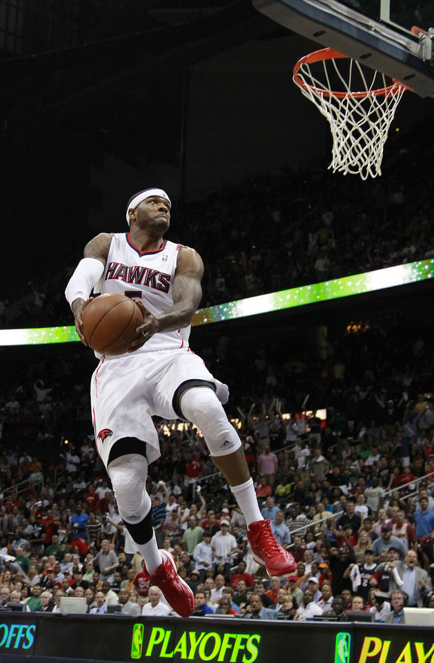 Photo -   Atlanta Hawks forward Josh Smith scores in the first half of Game 2 of an NBA basketball first-round playoff series against the Boston Celtics on Tuesday, May 1, 2012, in Atlanta. (AP Photo/John Bazemore)