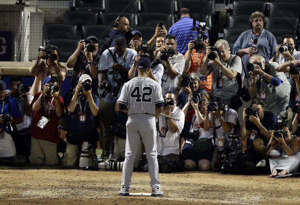 Photo - American League's Mariano Rivera, of the New York Yankees, poses for photographers after the MLB All-Star baseball game, on Tuesday, July 16, 2013, in New York. Rivera was named the game's MVP. (AP Photo/Frank Franklin II)