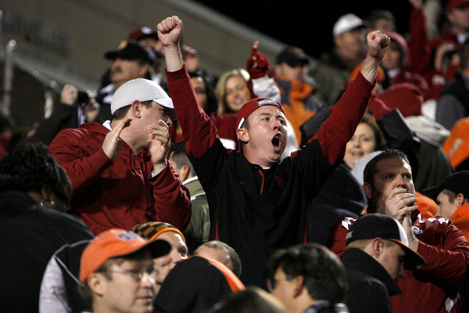 Photo - Fans celebrate a Sooner win following the Bedlam college football game between the University of Oklahoma Sooners (OU) and the Oklahoma State University Cowboys (OSU) at Boone Pickens Stadium in Stillwater, Okla., Saturday, Nov. 27, 2010. Photo by Sarah Phipps, The Oklahoman