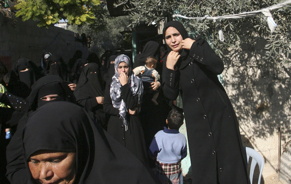 Photo -   Palestinian women react during the funeral of Hisham Al Galban, a Hamas militant killed in an Israeli attack, in Khan Younis, southern Gaza Strip, Thursday, Nov. 15, 2012. Israel barraged the Gaza Strip with airstrikes and shelling Wednesday and killed the Hamas military chief in a targeted strike, launching a campaign aimed at stopping rocket attacks from Islamic militants. The assault killed 10 other Palestinians, including two children and seven militants. On Thursday, militant rockets fired into Israel killed three Israelis, raising the likelihood of a further escalation.(AP Photo/Eyad Baba)