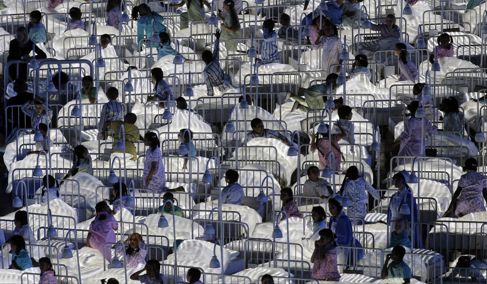 Actors enact a performance representing Britain's National Health Service (NHS) during the Opening Ceremony at the 2012 Summer Olympics, Friday, July 27, 2012, in London. (AP Photo/Christophe Ena)