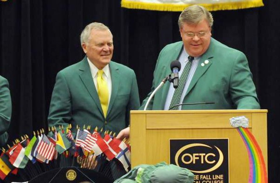 Photo - Georgia Governor Nathan Deal is introduced by District 150 State Representative Matt Hatchett moments after being presented a ceremonial green coat at the Joint Civic Luncheon in Dublin, Ga. Friday, March 15, 2013. Deal was the official guest speaker at the Dublin St. Patrick's Festival, which is currently in its 48th year. (AP Photo/The Herald, Jason Halcombe)