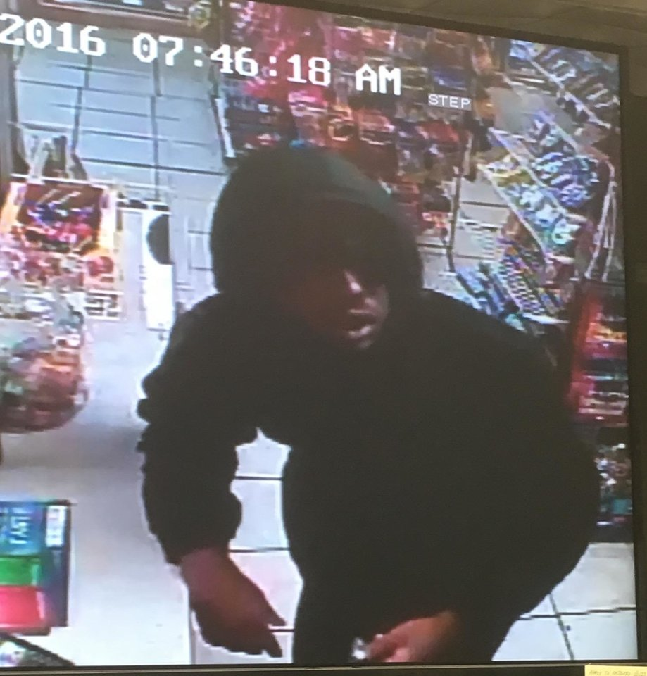 Photo -  Police are searching for a man wanted in connection with the shooting death of a store clerk Saturday morning. Anyone who recognizes the man should call Midwest City police at 739-1306.