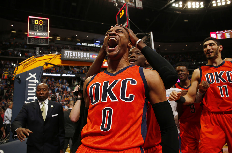Photo - Oklahoma City Thunder guard Russell Westbrook celebrates after hitting a buzzer beater three point shot to win the game against the Denver Nuggets following a basketball game Sunday, April 9, 2017, in Denver. Oklahoma City beat Denver 106-105. Westbrook also broke the NBA record for triple doubles with 42. (AP Photo/Jack Dempsey)