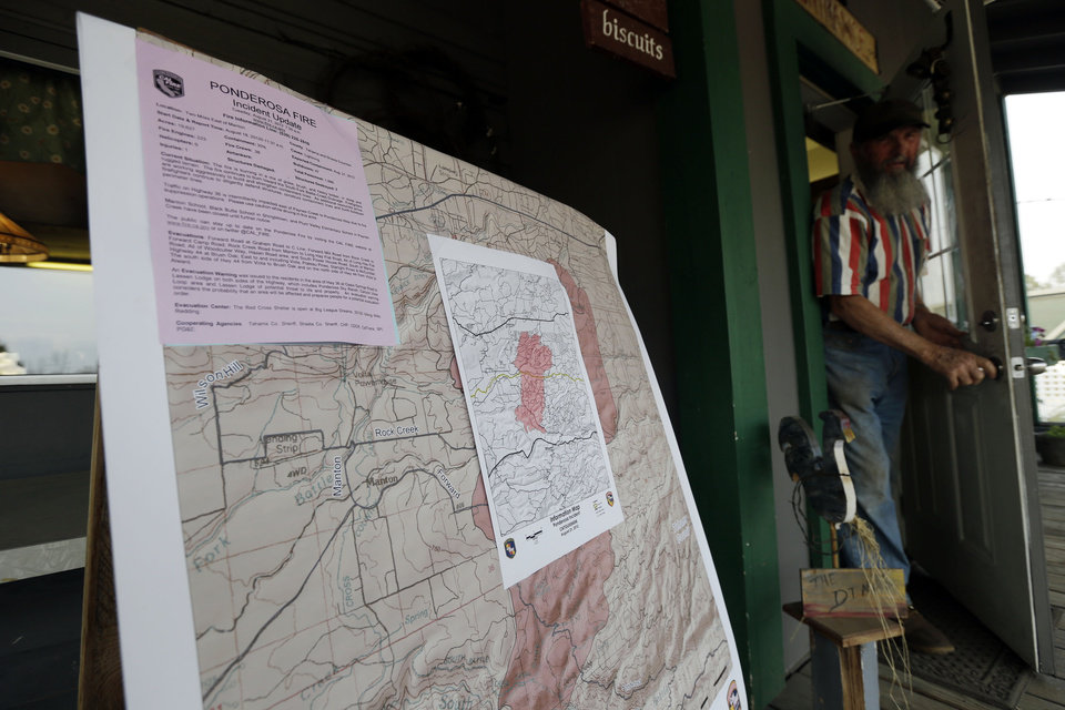 A map illustrates the path of the Ponderosa Fire outside of a diner in Manton, Calif., Friday, Aug. 24, 2012. Residents of the tiny mountain town of Mineral, Calif., breathed easier Friday after air tankers and helicopters blunted the run of a massive wildfire in Northern California just outside Lassen Volcanic National Park. Sixty-four homes and 20 other buildings have been destroyed, mostly in the Manton area, since lightning ignited the blaze Saturday. AP photo