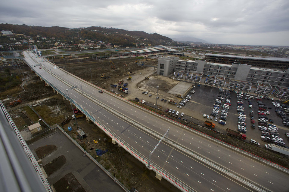 Photo - In this photo taken on Wednesday, Nov. 27, 2013,  a new highway is seen on the fringes of the Olympic park in Sochi, Russia. As the Winter Games are getting closer, many Sochi residents are complaining that their living conditions only got worse and that authorities are deaf to their grievances.  (AP Photo/Alexander Zemlianichenko)