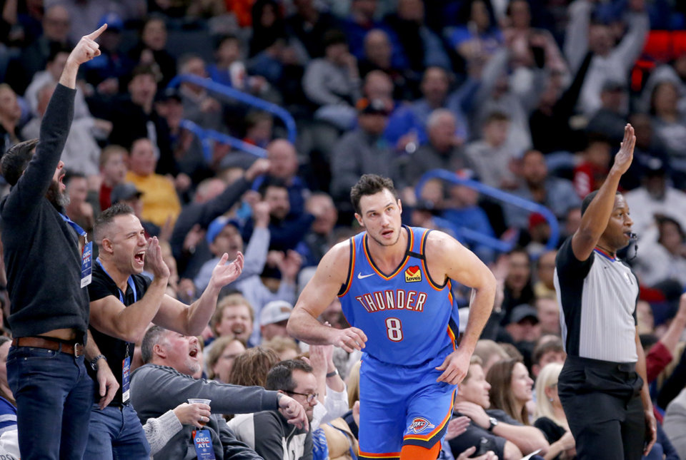 Photo - Fans cheer after an Oklahoma City's Danilo Gallinari (8) 3-point basket during the NBA basketball game between the Oklahoma City Thunder and the Atlanta Hawks at the Chesapeake Energy Arena in Oklahoma City,Friday, Jan. 24, 2020.  [Sarah Phipps/The Oklahoman]