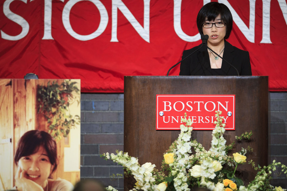 Zheng Minhui a classmate of Lu Lingzi, speaks of Lingzi during her memorial service at Metcalf Hall in Boston University's George Sherman Student Union on Monday, April 22, 2013. Lingzi was killed in the Boston Marathon bombings. (AP Photo/The Boston Globe, Dina Rudick, Pool)