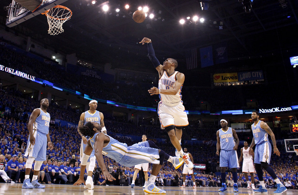 Oklahoma City's Russell Westbrook (0) puts up a shot over Denver's Nene (31)during the first round NBA playoff game between the Oklahoma City Thunder and the Denver Nuggets on Sunday, April 17, 2011, in Oklahoma City, Okla. Photo by Chris Landsberger, The Oklahoman