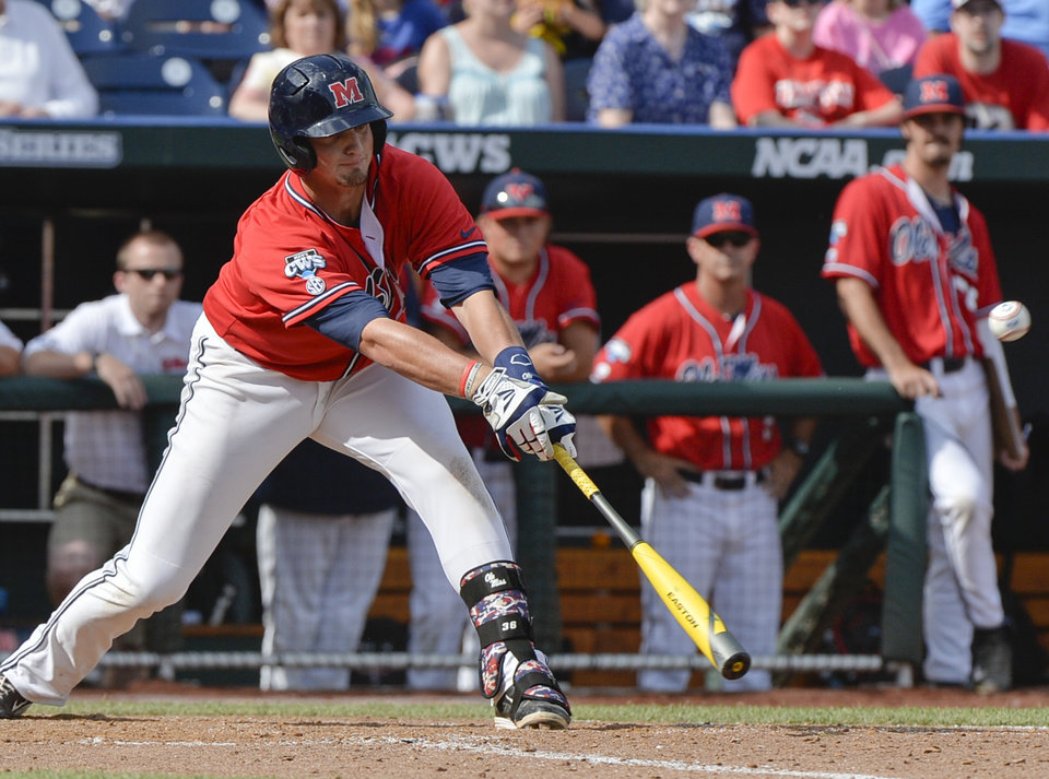 Photo - Mississippi infielder John Gatlin (36) hits a single in the ninth inning against Texas Tech that scored teammate Aaron Greenwood in an NCAA baseball College World Series elimination game in Omaha, Neb., Tuesday, June 17, 2014. Mississippi won 2-1. (AP Photo/Ted Kirk)