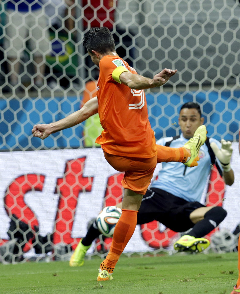 Photo - Costa Rica's goalkeeper Keylor Navas (1) stops a shot by Netherlands' Robin van Persie (9) during the World Cup quarterfinal soccer match between the Netherlands and Costa Rica at the Arena Fonte Nova in Salvador, Brazil, Saturday, July 5, 2014. (AP Photo/Hassan Ammar)