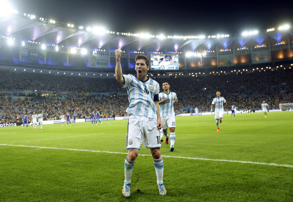 Photo - In this Sunday, June 15, 2014 photo, Argentina's Lionel Messi celebrates scoring his side's second goal during the group F World Cup soccer match between Argentina and Bosnia at the Maracana Stadium in Rio de Janeiro, Brazil. After a frustrating first half, the Argentina captain scored in trademark style in the 65th minute on Sunday night, completing a quick 1-2 connection with Gonzalo Higuain and running through defenders before striking a brilliant left-footed shot off the post. (AP Photo/Victor R. Caivano)