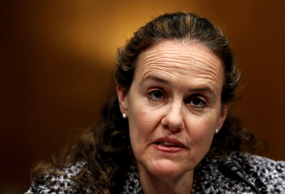 Photo - FILE - This Feb. 22, 2010 file photo shows then-Defense Undersecretary for Policy Michele Flournoy testifying on Capitol Hill in Washington. Senior administration officials tell The Associated Press that President Barack Obama could name his next defense secretary in December, far sooner than expected and perhaps in a high-powered package announcement along with his choice for secretary of state. The top names under consideration for defense secretary are former Republican Sen. Chuck Hagel of Nebraska, deputy defense secretary Ashton Carter, former top Pentagon official Michele Flournoy, and Sen. John Kerry, D-Mass.   (AP Photo/Manuel Balce Ceneta, File)